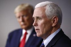 In this March 22, 2020, file photo Vice President Mike Pence speaks alongside President Donald Trump during a coronavirus task force briefing at the White House in Washington