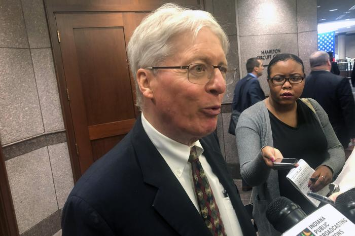 James Bopp, the attorney for conservative religious groups speaks with reporters at the Hamilton County government center in Noblesville, Ind.