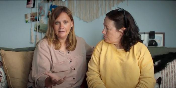 A screenshot of the lesbian couple seen in one of the Dole Fruit Bowl commercials