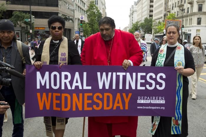 In this Wednesday, June 12, 2019 file photo, The Rev. Dr William Barber, center, accompanied by faith leaders, march to the White House in Washington protesting against President Donald Trump policies