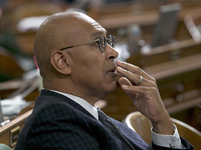 Assemblyman Chris Holden, D-Pasadena, watches as the votes are posted for a measure at the Assembly in Sacramento, Calif.