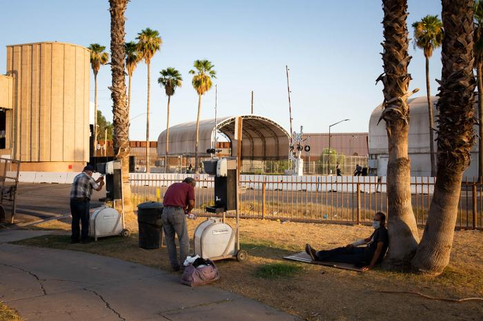 Each evening, volunteers serve a hot meal to anyone in need at Border Friendship Park in Calexico, California. After Imperial County closed public bathrooms, organizers fought to have hand-washing stations installed so the people they feed can wash up.