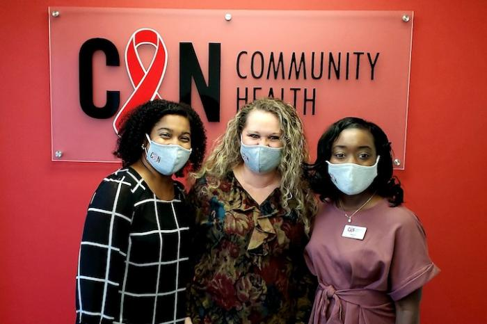 Demetris McDowell, Practice Administrator (left), Shannon Dewitt, Front Desk Receptionist (center), and Nadia Winston, Nurse Practitioner (right)