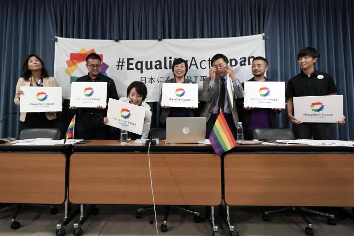 "From left, Yumiko Murakami, head of OECD Tokyo, Gon Matsunaka, head of Pride House Tokyo Legacy, Kanae Doi, Japan Director of Human Rights Watch, Yuri Igarashi, co-representative director of the Japan Alliance for LGBT Legislation, Yuichi Kamiya, secretary-general of the Japan Alliance for LGBT Legislation, ""Tokyo Rainbow Pride"" representative co-director Fumino Sugiyama, and a soccer player Shiho Shimoyamada, prepare to pose for photographers during a press conference to launch international signature campaign for the enactment of the ""LGBT Equality Law"" as a legacy of the Tokyo Olympics."