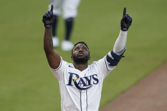 Tampa Bay Rays Randy Arozarena celebrates after hitting a two run home run against the Houston Astros during the first inning in Game 7 of a baseball American League Championship Series, Saturday, Oct. 17, 2020, in San Diego. (AP Photo/Ashley Landis)