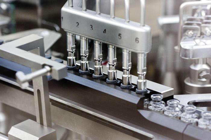 Rubber stoppers are placed onto filled vials of the investigational drug remdesivir at a Gilead manufacturing site in the United States.