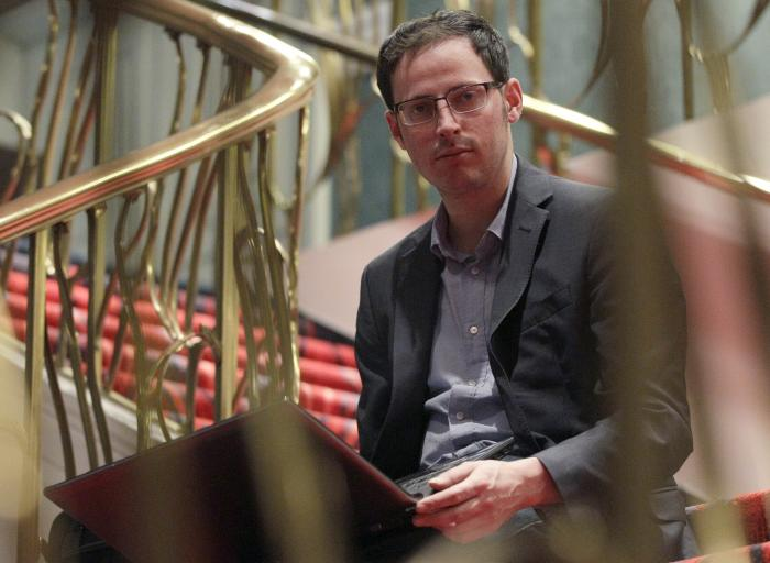 Nate Silver sits on the stairs at Allegro hotel in downtown Chicago.