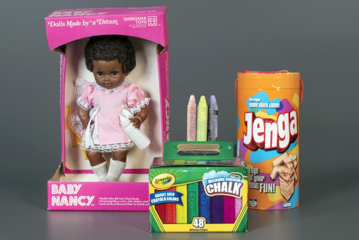 Baby Nancy, by Shindana Toys; Sidewalk Chalk, by Crayola; and Jenga, by Parker Brothers, left to right, that were inducted into the National Toy Hall of Fame.