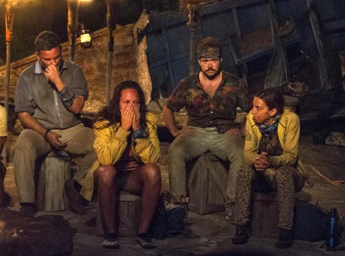 """From left, Jeff Varner, Sarah Lacina, Zeke Smith and Debbie Wanner appear at the Tribal Council portion of the competition series """"Survivor: Game Changers."""""""
