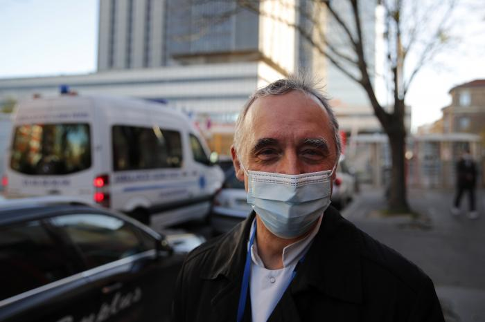 Dr. Philippe Montravers speaks with The Associated Press at the main entrance of the Bichat Hospital, in Paris on Tuesday, Nov. 10, 2020.