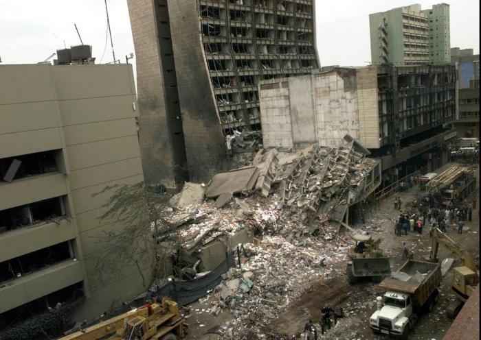 This Aug. 8, 1998, file photo shows the United States Embassy, left, and other damaged buildings in downtown Nairobi, Kenya, the day after terrorist bombs in Kenya and Dar es Salaam, Tanzania.