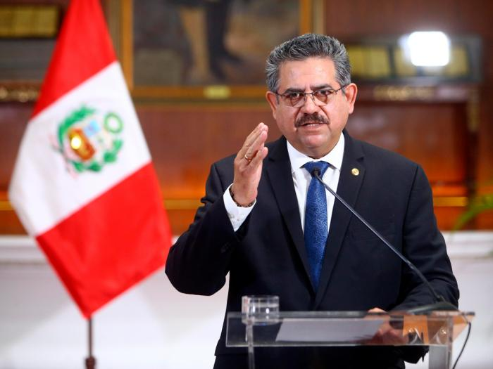 In this photo released by Peru's Presidential Palace, Peru's interim president Manuel Merino announces his resignation via a televised address from the Presidential Palace in Lima, Peru, Sunday, Nov. 15, 2020