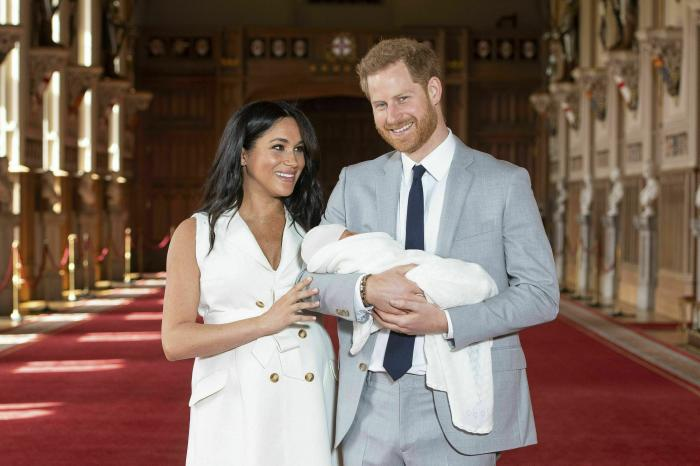Britain's Prince Harry and Meghan, Duchess of Sussex, pose during a photocall with their newborn son Archie, in St George's Hall at Windsor Castle, Windsor, south England.