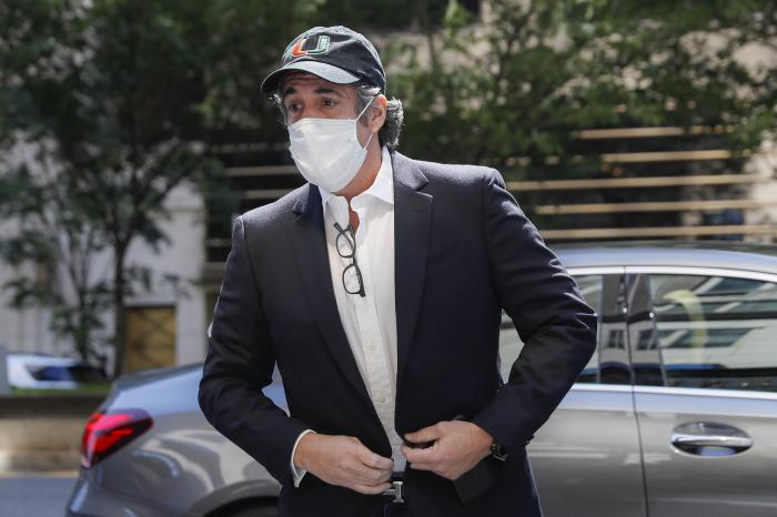 Michael Cohen arrives at his Manhattan apartment in New York after being furloughed from prison because of concerns over the coronavirus.