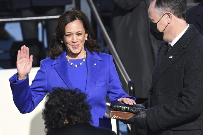 Kamala Harris is sworn in as vice president by Supreme Court Justice Sonia Sotomayor as her husband Doug Emhoff holds the Bible during the 59th Presidential Inauguration at the U.S. Capitol in Washington.