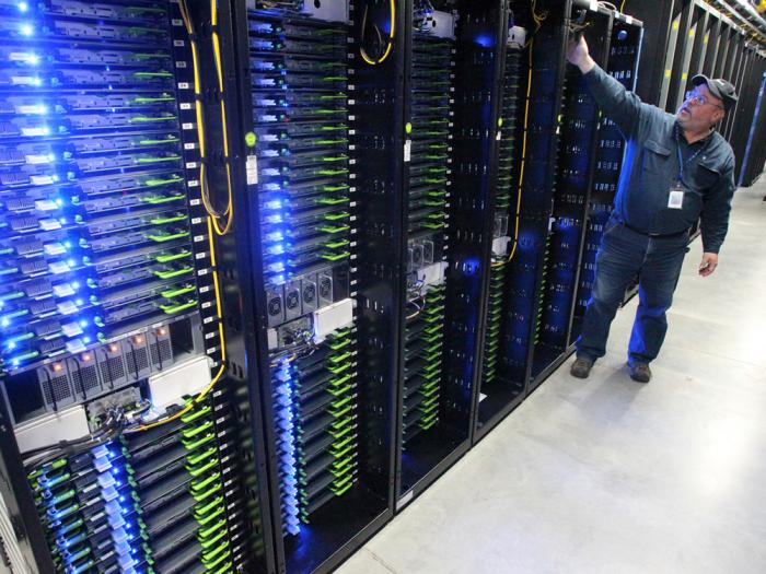 In this Oct. 15, 2013 file photo, Chuck Goolsbee, site director for Facebook's Prineville data centers, shows the computer servers that store users' photos and other data at the Facebook site in Prineville Ore.