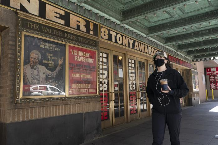 A woman walks past the Walter Kerr Theatre, Thursday, May 6, 2021, in New York.