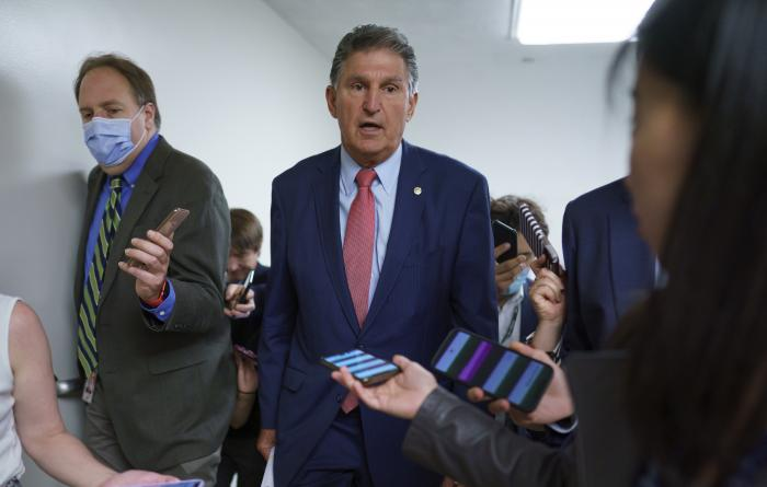 Sen. Joe Manchin, D-W.Va., is surrounded by reporters as senators rush to the chamber for votes ahead of the approaching Memorial Day recess, at the Capitol in Washington, Wednesday, May 26, 2021.