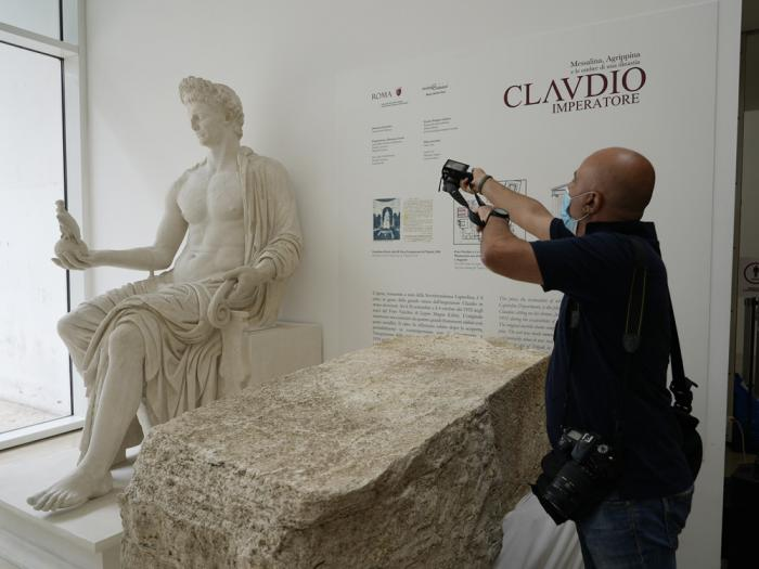 A photographer takes pictures during the presentation to the press of an archeological finding emerged during the excavations at a Mausoleum in Rome, Friday, July 16, 2021