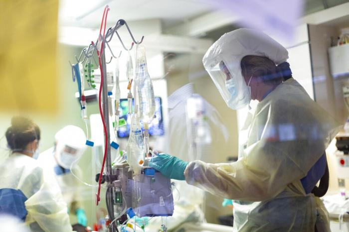 Jack Kingsley R.N. attends to a COVID-19 patient in the Medical Intensive care unit (MICU) at St. Luke's Boise Medical Center in Boise, Idaho.