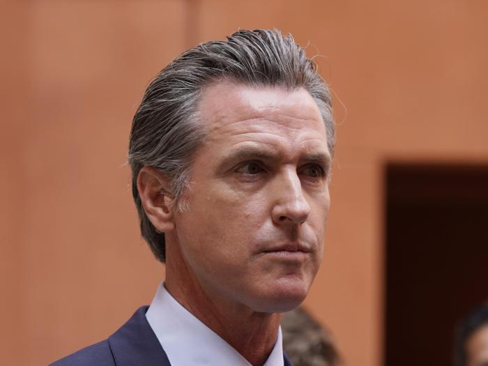 California Gov. Gavin Newsom listens to a question while meeting with reporters after casting his recall ballot at a voting center in Sacramento, Calif., Friday, Sept. 10, 2021